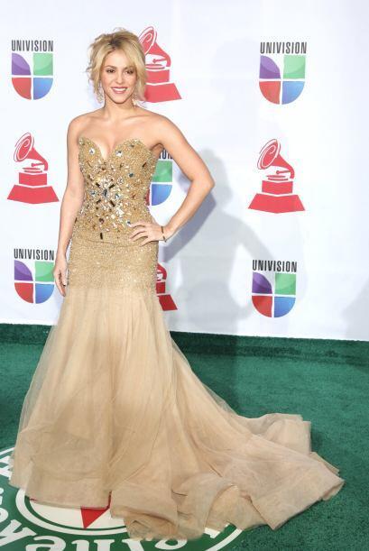 Otra excelente decisión 'fashionista' fue este vestido con escote...