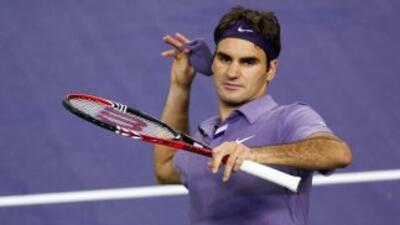 Federer lanzó su muñequera a la pista como muestra de celebración, conta...