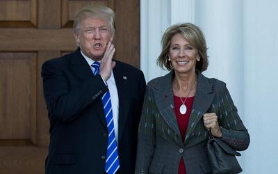 President-elect Donald Trump with his choice for Education Secretary, Be...
