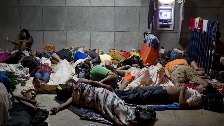 Migrantes cubanos en un albergue en Centroamérica