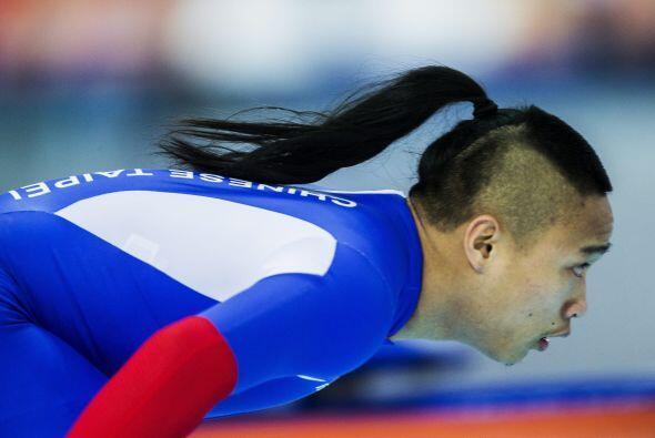 El patinador taiwanés Ching-Yang Sung participa en un entrenamiento para...