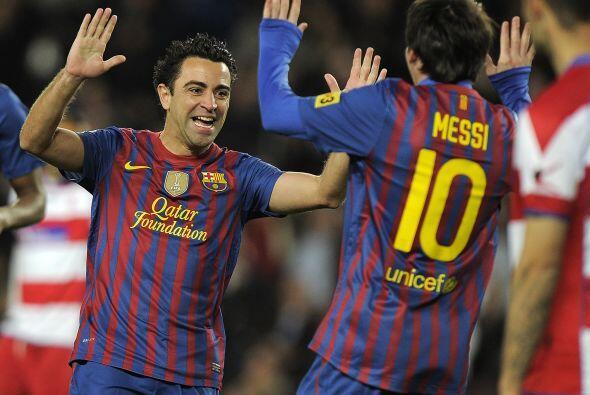 En el festejo, Xavi y Messi festejaron la apertura del marcador.
