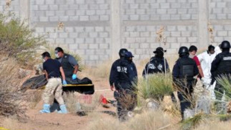 El personal de la Agencia de Investigación Criminal (AIC) para el rescat...