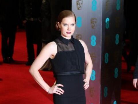 De las más glamourosas de esta 'red carpet' del BAFTA 2014 fue Am...