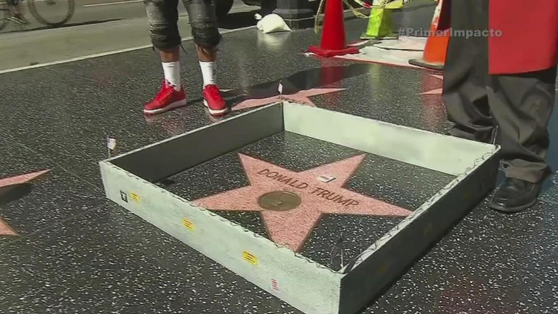 Cercan la estrella de Donald Trump en el paseo de la fama de Hollywood