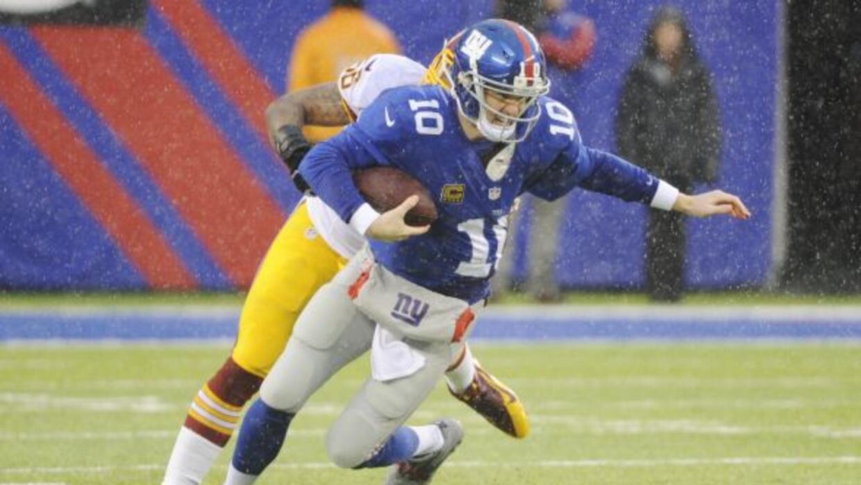 Eli Manning no tuvo su mejor temporada en 2013 (AP-NFL).