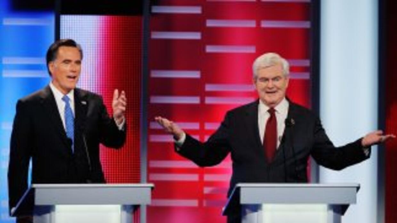 Romney y Gingrich empatados semanas antes de la primaria en Iowa.