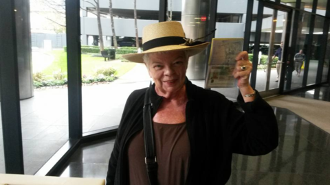 Marsha Scarbrough shows off the visa that will allow her to live in Spai...