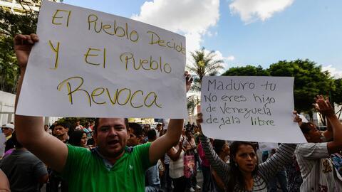Oposición venezolana convoca protestas de calle tras la imposibilidad de...