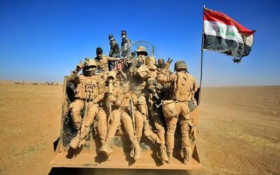 Tropas iraquíes se despliegan durante una ofensiva para recuperar...