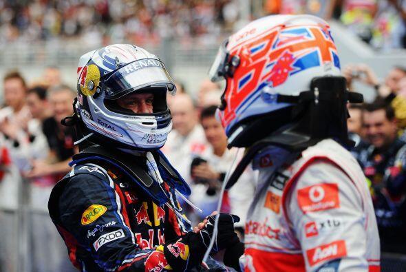 Button fue el primero en felicitar a Vettel por su impresionante victoria.