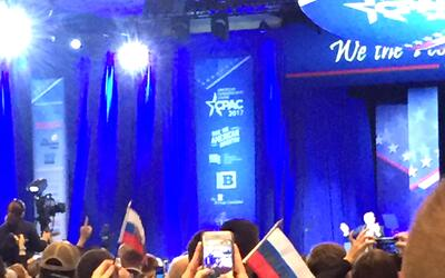 "A LMAO moment captured @ CPAC. Crowd waving ""Trump"" flags that..."