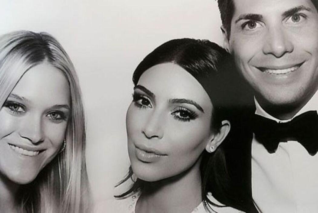 Kim con Joe Francis y Abby Wilson.