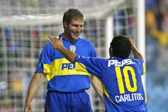 Con Carlos Tevez, su ex compañero de equipo. Martín dijo q...