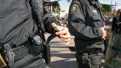 Al menos 15 policías mexicanos de la fronteriza ciudad de Tijuana fueron...