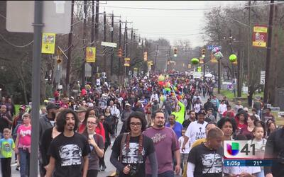 Miles de personas acuden a la marcha en conmemoración a Martin Luther Ki...