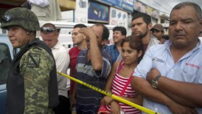 El cuerpo del subdelegado en Sinaloa de la Procuraduría General de la Re...