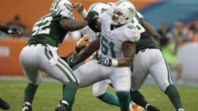 Mike Pouncey es vital en los Dolphins (AP-NFL).