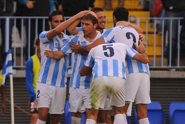 Málaga empató provisionalmente con un cabezazo de De Michelis.