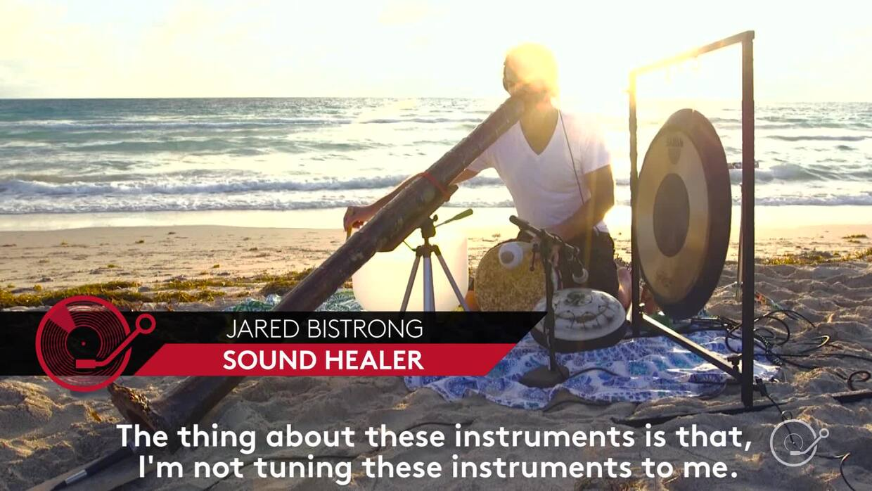 This sound healer crafts didgeridoos out of palm trees