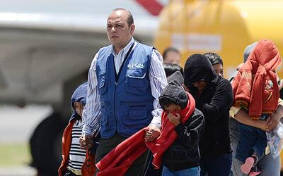 A group of deported Guatemalans are received at the Guatemala City airport.