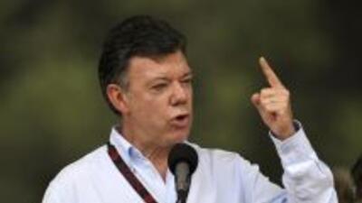 El presidente Juan Manuel Santos instó a las FARC a que depongan las arm...