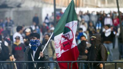 Mexican flag with an anti-PRI sign against President Peña Nieto