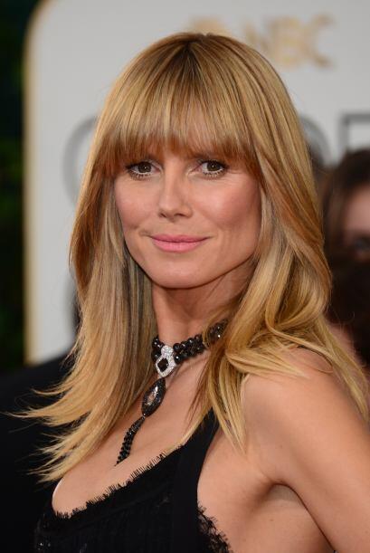 La bella Heidi Klum lució su cabello rubio y largo en capas, con un fleq...