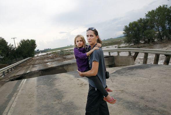 En esta zona, y en Evergreen, el torrente de agua destruyó gran parte de...