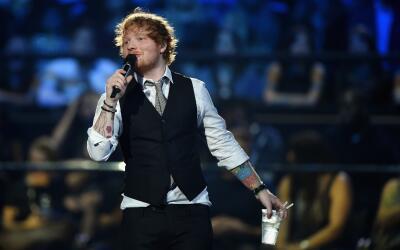 MILAN, ITALY - OCTOBER 25: Host Ed Sheeran speaks during the MTV EMA's 2...