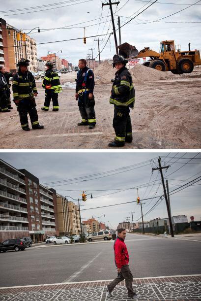 El 31 de octubre de 2012, los bomberos caminaban por las devastadas call...