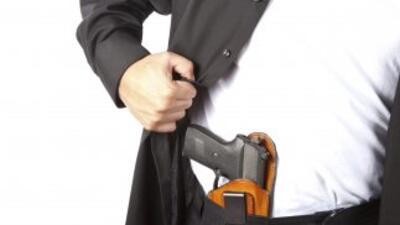 La ley permite la entrada con armas a iglesias y bares que no se opongan...