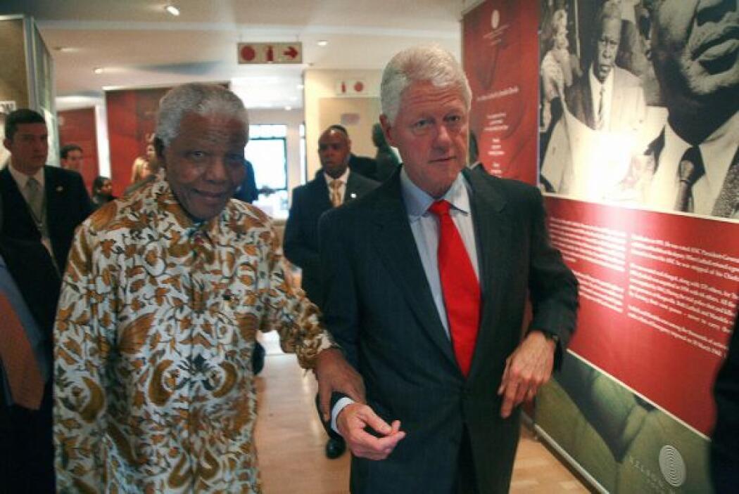 Bill Clinton posa con Mandela.