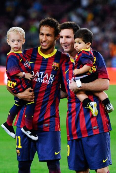 El brasileño y el argentino posaban orgullosos con sus respectivos hijos...
