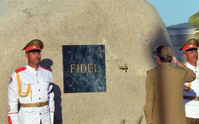 Raul Castro salutes the tomb of his older brother Fidel Castro shortly a...