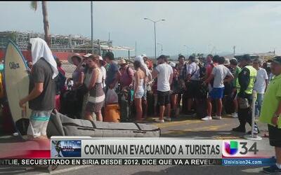 Turistas y locales tratan de volver a la normalidad