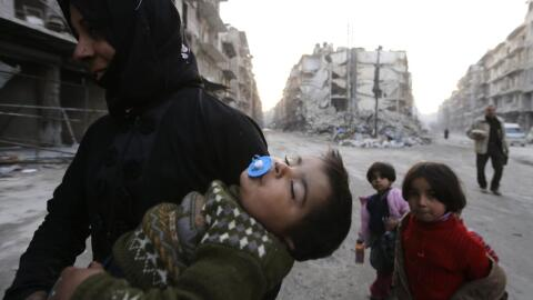 A woman with her son and two other children in Aleppo.