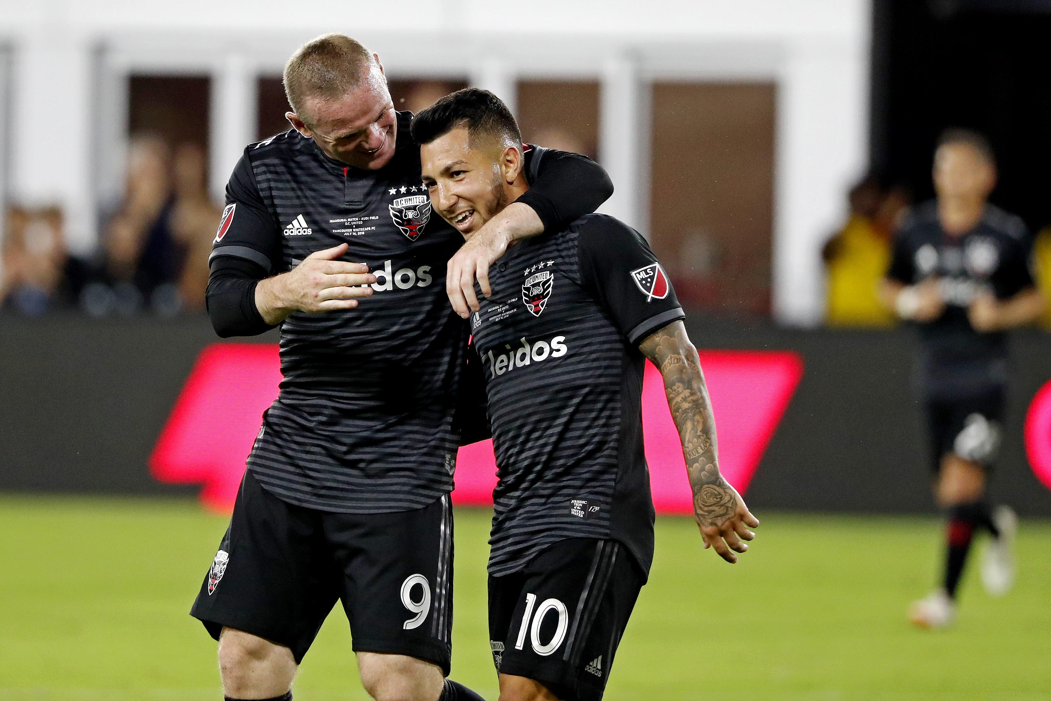 Image result for Wayne Rooney with Luciano Acosta