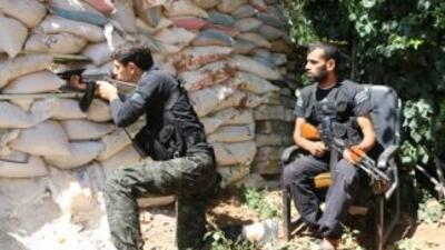 Combatientes de la oposición siria moderada en desacuerdo con el Estado...