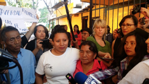 Teodora del Carmen Vásquez stood with her parents Thursday outside the p...