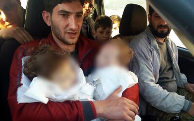 Aaque químico Siria rostros cubiertos
