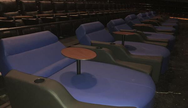Couple lounges right in the front of the movie theatre.