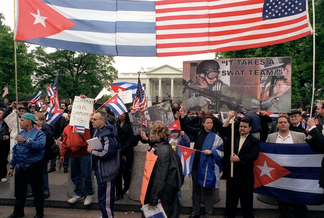 WASHINGTON, :  Protesters carry signs and flags during a demonstration 2...