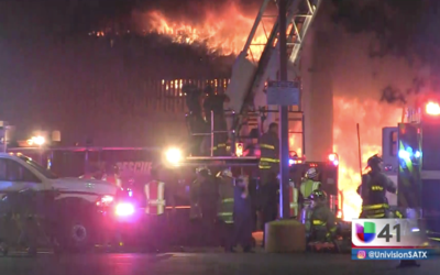 San Antonio Fire Department responding to a four-alarm fire on the city'...