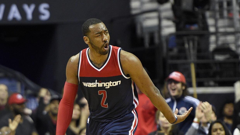 John Wall brilló por Washington con 21 puntos y 13 asistencias.