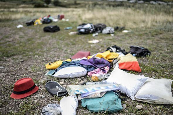 Así lucían esparcidos los objetos del equipaje de algunos pasajeros del...