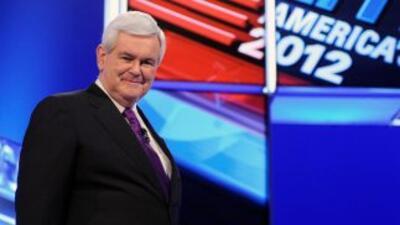 El aspirante republicano a la nominación presidencial, Newt Gingrich, co...