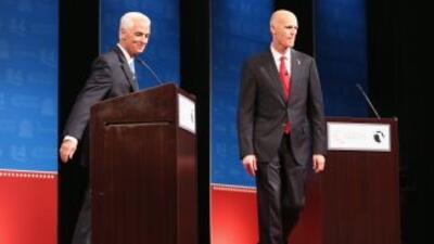 El demòcrata Charlie Christ y el republicano Rick Scott durante el debat...
