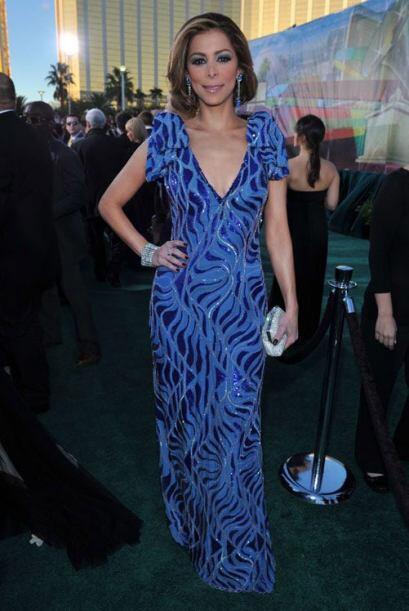 Y en 2010 eligió un vestido azul escotado.