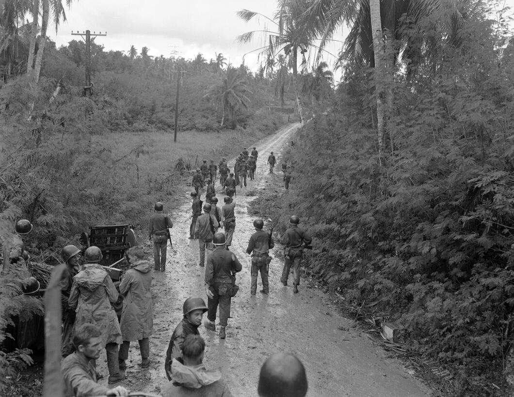 U.S. Marines move forward in the rain, toward junction with 1st Marine B...